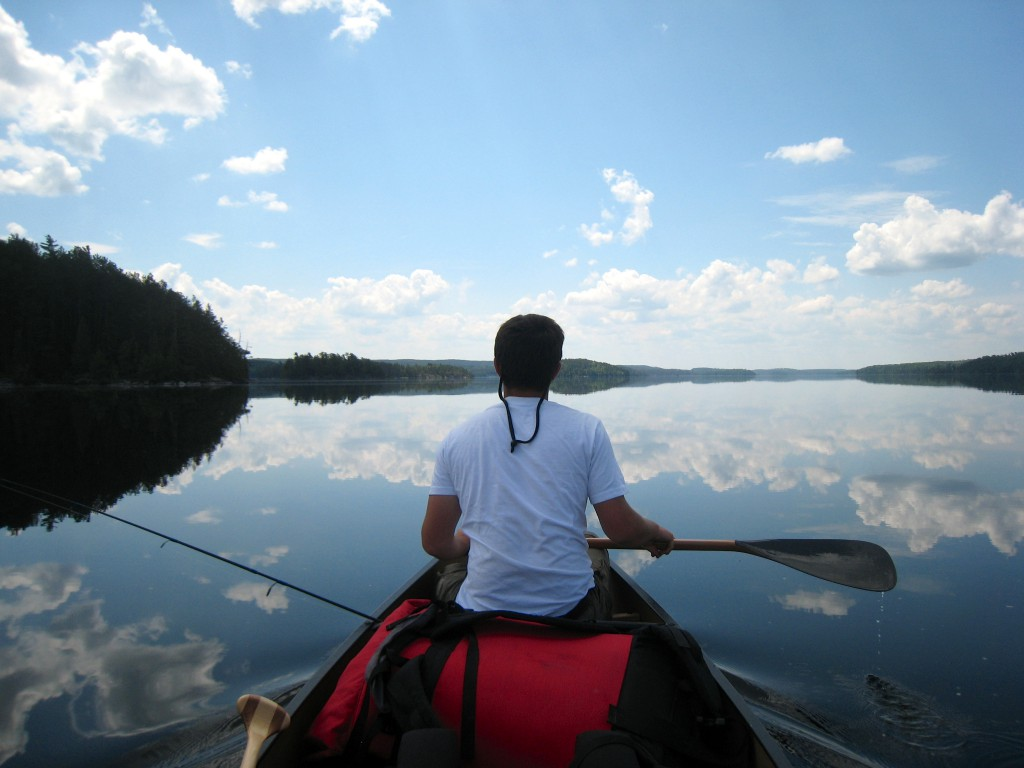 Quetico Provincial Park paddling reflection Ontario canoe trip boundary waters